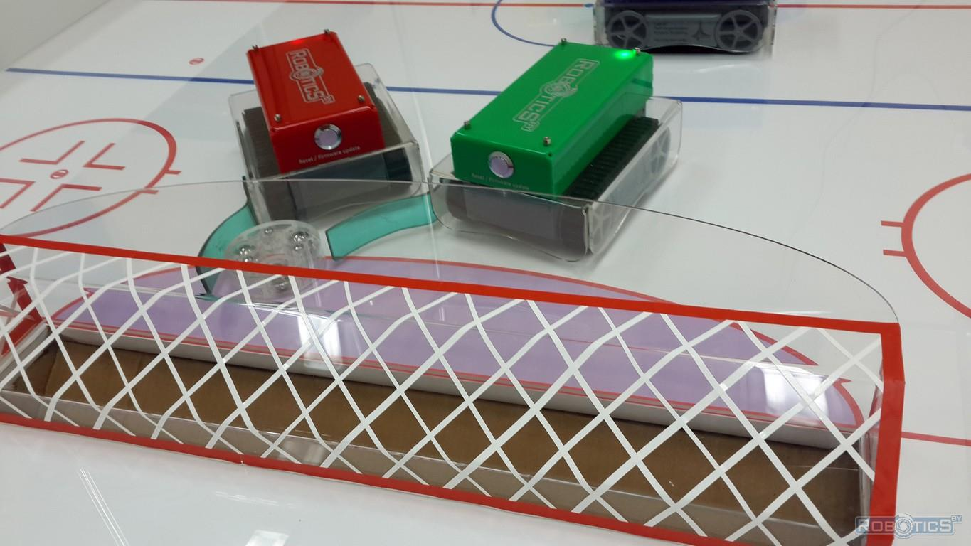 A group game of mobile robots in robo-hockey arena in Minsk.