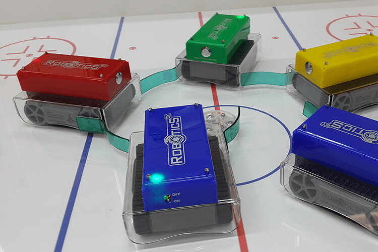 Puck draw by robo-hockey players