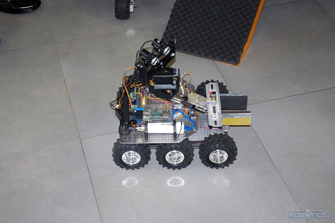 Mobile six-wheeled robot equipped with a gripper.