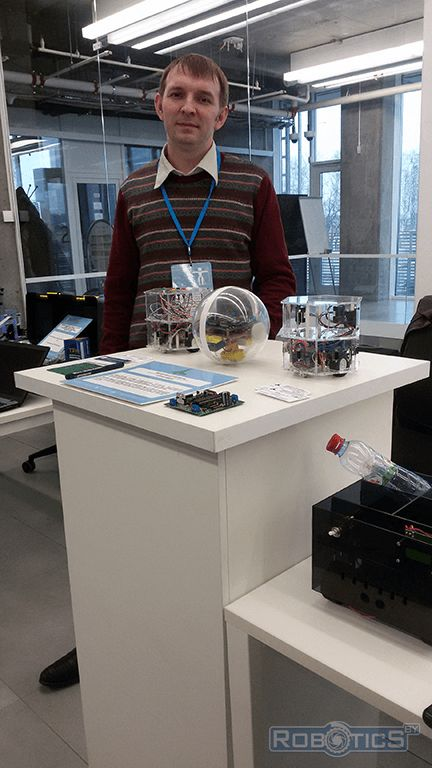 Gerasyuto Sergey Leonidovich near the display stand with robots UIIP NASB robotics sector.