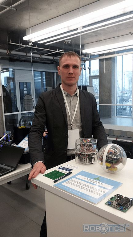 Prokopovich Grigoriy Aleksandrovich near the demonstration stand with robots UIIP NASB robotics sector.