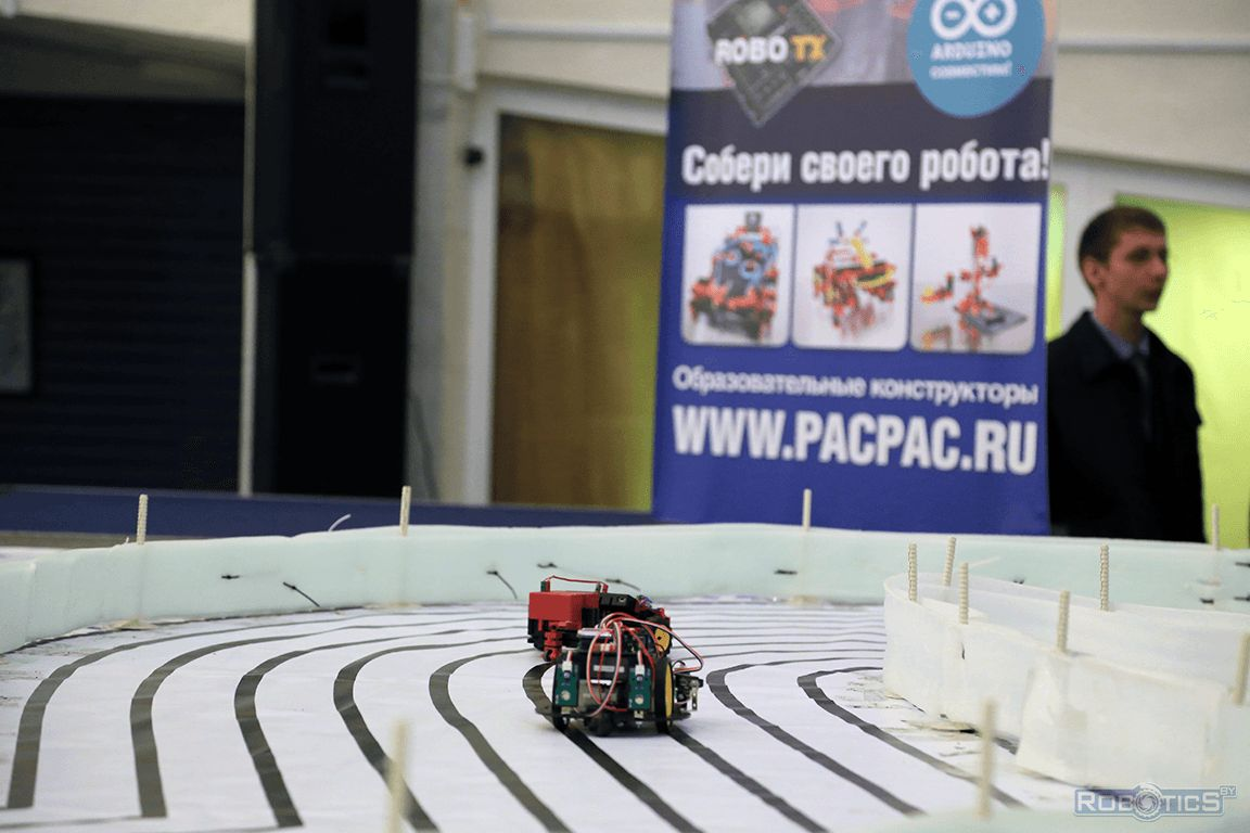 Racing robots on track.