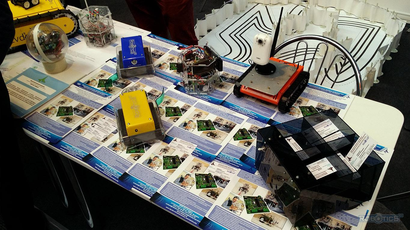 Demonstration of robots in the sector of robotics exhibition stand.
