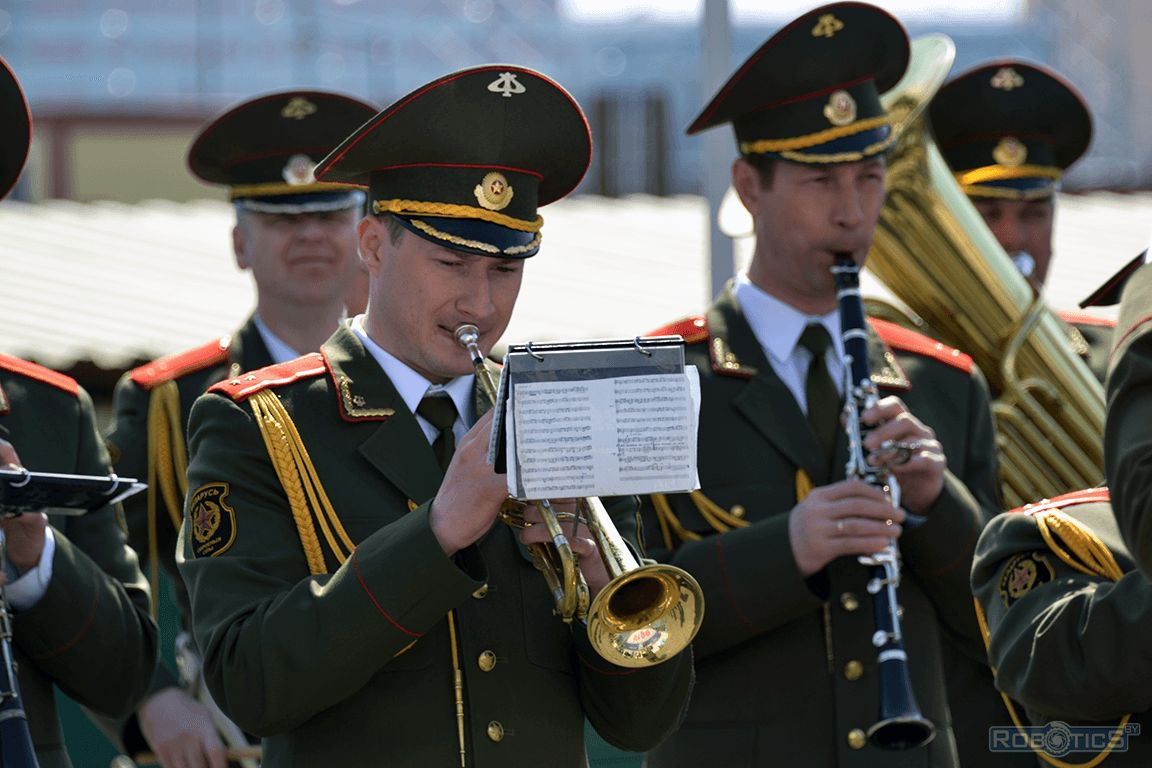 Performance of the brass band at the opening ceremony of the holiday.