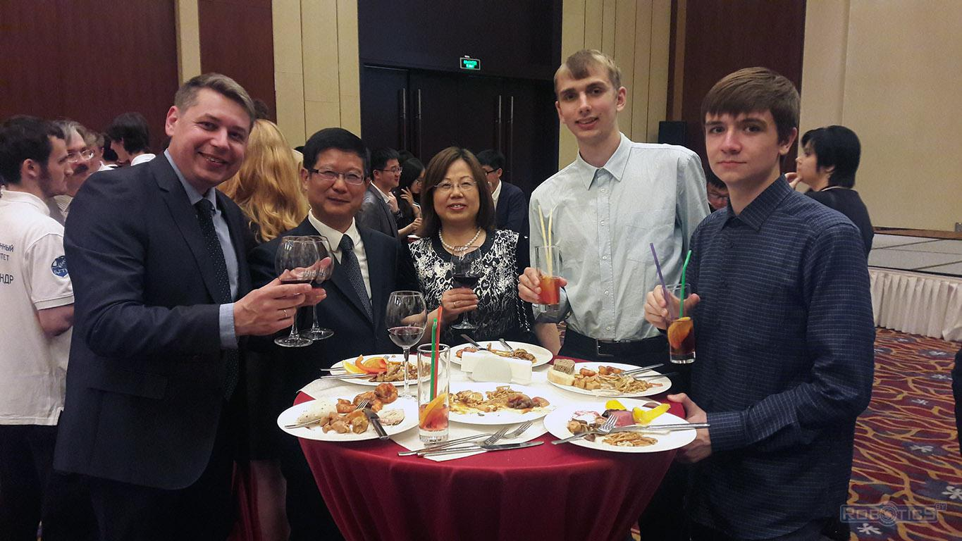Dmitry Samal with the team from BSUIR (3-4 seats) at the reception at the Chinese Embassy, Beijing hotel.